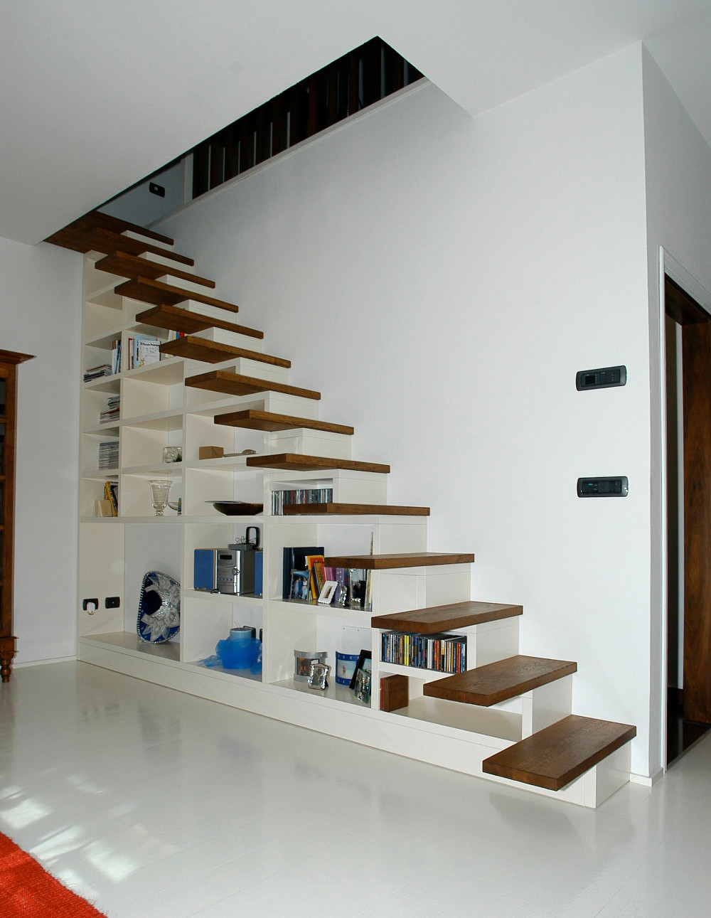 Bettoli arredi e pavimenti scale contenitive bettoli for Scala per libreria